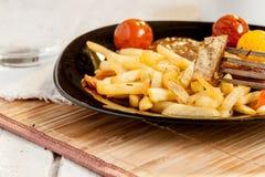 Vegetarian steak from vegan meat seitan, cherry tomatoes and fries Royalty Free Stock Photo
