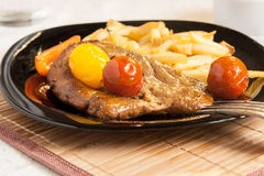 Vegetarian steak from vegan meat seitan, cherry tomatoes and fries Royalty Free Stock Photos