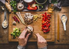 Free Vegetarian Stir Fry Cooking Preparation. Women Female Hands Cut Vegetables For Stir Fry On Kitchen Table Background With Ingredien Royalty Free Stock Image - 102268216