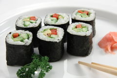 Vegetarian Sushi. And ginger on a white plate Royalty Free Stock Photography