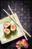 Vegetarian sushi with flowers Stock Images