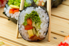 Vegetarian sushi roll Stock Images