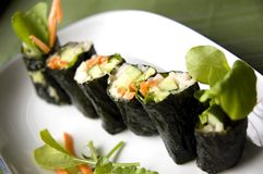 Vegetarian sushi roll on plate Stock Image