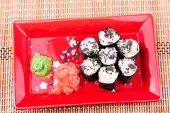 Vegetarian sushi roll served on a red plate Royalty Free Stock Photo