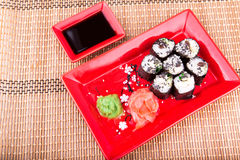 Vegetarian sushi roll served on a red plate Royalty Free Stock Photography
