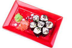Vegetarian sushi roll served on a red plate Royalty Free Stock Photos