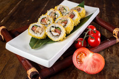Vegetarian sushi roll. With tomatoes on wooden table Royalty Free Stock Photos