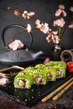Vegetarian sushi rolls avocado with cream Philadelphia cheese, sesame, unagi sauce. Sushi menu. stock images