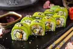 Free Vegetarian Sushi Rolls Avocado With Cream Philadelphia Cheese, Sesame, Unagi Sauce. Royalty Free Stock Images - 123012349