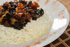 Vegetarian sweet rice with dried apricots and raisins close-up on the table. royalty free stock photography
