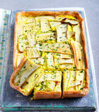 Vegetarian tart with cheese and spinach and zucchini Stock Photography