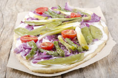 Vegetarian tarte flambee on brown paper Stock Images