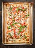 Vegetarian tarte flambee on old baking pan Stock Image