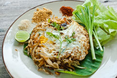 Vegetarian thai food (Pad Thai). Vegetarian thai food-stir-fried rice noodles (Pad Thai) on wooden table Stock Photos