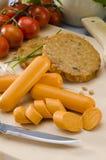 Vegetarian tofu burger and tofu sausage. Stock Photography