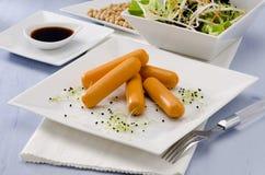 Vegetarian tofu sausage. Stock Photos