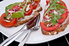 Vegetarian tomato bread with cutlery Royalty Free Stock Photography