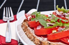 Vegetarian tomato bread with cutlery Stock Image