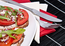 Vegetarian tomato bread with cutlery Royalty Free Stock Photos