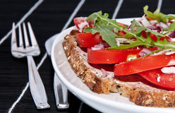 Vegetarian tomato bread with cutlery Stock Photo