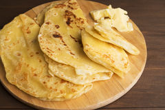 Vegetarian tortilla with potatoes and butter. Laid out on a wooden Board and brown table Royalty Free Stock Photography