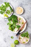 Vegetarian traditional Vietnamese soup Pho bo with herbs, rice noodles, broccolini, bok choy. Asian food concept. stock photo
