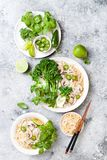 Vegetarian traditional Vietnamese soup Pho bo with herbs, rice noodles, broccolini, bok choy. Asian food concept. Vegetarian traditional Vietnamese soup Pho bo royalty free stock photo