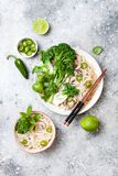 Vegetarian traditional Vietnamese soup Pho bo with herbs, rice noodles, broccolini, bok choy. Asian food concept. Vegetarian traditional Vietnamese soup Pho bo stock photography
