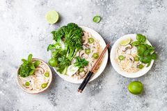 Vegetarian traditional Vietnamese soup Pho bo with herbs, rice noodles, broccolini, bok choy. Asian food concept. royalty free stock images