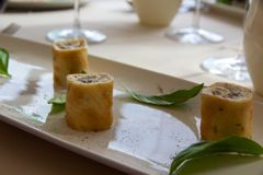 Vegetarian truffle and egg roll appetizer on plate, Istria, Croatia. Thin egg omelettes are wrapped around creamy cheese with fresh truffles in Istria, Croatia stock photography