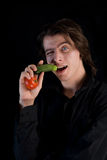 Vegetarian vampire with vegetables Royalty Free Stock Photo