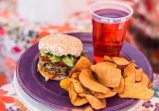 Vegetarian vegan burger and raspberry lemonade at a street food market royalty free stock photo