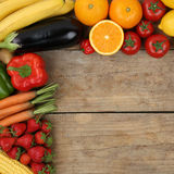 Vegetarian and vegan fruits and vegetables on wooden board with Royalty Free Stock Photo