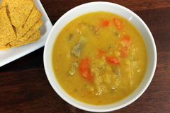 Vegetarian/Vegan Yellow Split Pea Soup with Crackers. On a Dark Wood Table stock photo