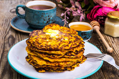 Vegetarian vegetable fritters with honey, tea in vintage cup royalty free stock photos