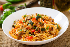 Vegetarian Vegetable pasta Fusilli with zucchini, mushrooms and capers in white bowl Royalty Free Stock Photos