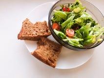 Vegetarian vegetable salad. Fresh salad flying to bowl in super slow motion. Avocado Tomato Salad.  stock photo