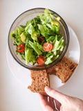 Vegetarian vegetable salad. Fresh salad flying to bowl in super slow motion. Avocado Tomato Salad.  royalty free stock images