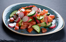 Vegetarian vegetable salad on a plate. Close up stock photos