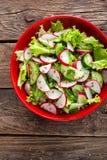 Vegetarian vegetable salad of radish, cucumbers, lettuce salad and flax seeds. Healthy  vegan food. Top view Royalty Free Stock Photos