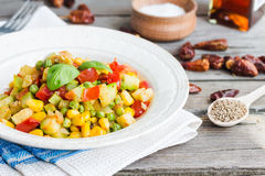 Vegetarian vegetable stew with peas and corn, curry, healthy din Stock Photo
