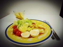 Vegetarian vegetables lunch dinner romantic eat. Water lemon juice sausage salat tomato Stock Photography