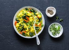 Vegetarian vegetables and yellow lentils stew on dark background stock photo