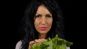 Vegetarian woman healthy eating fresh green salad. Vegetarian young woman healthy eating fresh green salad stock video