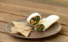 Vegetarian wrap. With lettuce, tomatoes and carrots Stock Photo