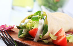 Vegetarian wrap sandwich. Tortilla filled with fresh vegetables Royalty Free Stock Images