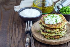 Vegetarian zucchini fritters or pancakes, served with greek yogu Stock Images