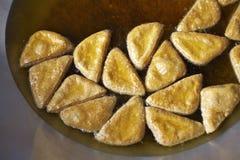Vegetarianfood in thailand. Yellow tofu fried in large pan Royalty Free Stock Photos
