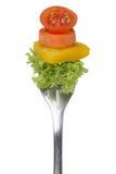 Vegetariano, verdura o vegano mangianti insalata con la forcella isolata Immagini Stock