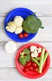 Vegetarianos nas placas de papel Foto de Stock
